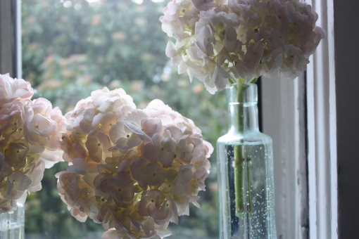 light pink hydrangeas to give a little love in these jeweled bottles